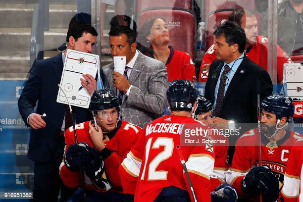 Florida Panthers Head Coach Bob Boughner chats with Assistant Coach Paul McFarland and Associate Coach Jack Capuano during a break in the action...