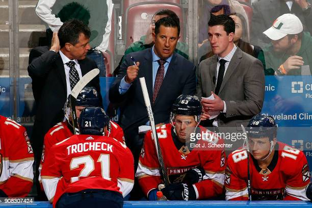 Florida Panthers Head Coach Bob Boughner chats with Associate Coach Jack Capuano and Assistant Coach Paul McFarland during a break in the action...