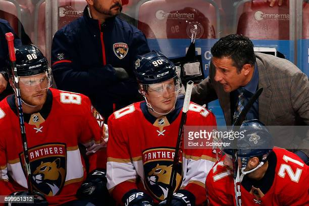 Florida Panthers Head Coach Bob Boughner chats with Jared McCann and Jamie McGinn during a break in the action against the Philadelphia Flyers at the...