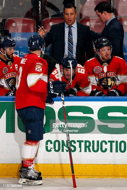 Florida Panthers Head Coach Bob Boughner chats with Keith Yandle during a break in the action against the Boston Bruins at the BBT Center on March 23...