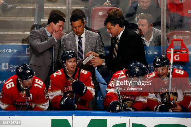 Florida Panthers Head Coach Bob Boughner comes up with a plan on the bench with Assistant Coach Paul McFarland and Associate Coach Jack Capuano...