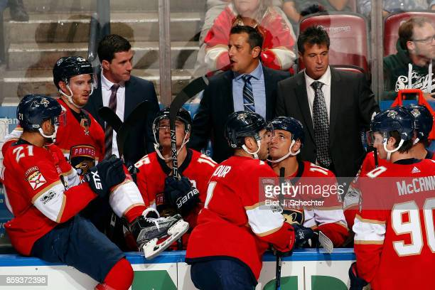 Florida Panthers Head Coach Bob Boughner directs his team from the bench along Assistant Coach Paul McFarland and Associate Coach Jack Capuano during...