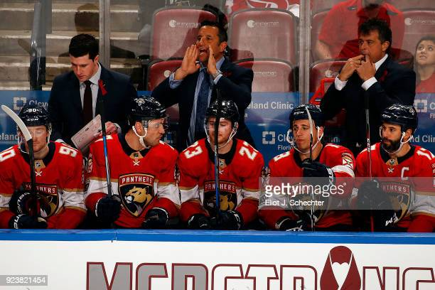 Florida Panthers Head Coach Bob Boughner directs his team in the third period along with Assistant Coach Paul McFarland and Associate Coach Jack...