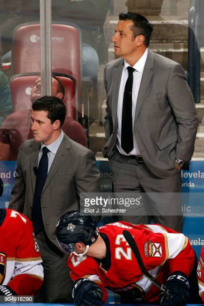 Florida Panthers Head Coach Bob Boughner stands on the bench to get a better view along with Assistant Coach Paul McFarland against the Calgary...