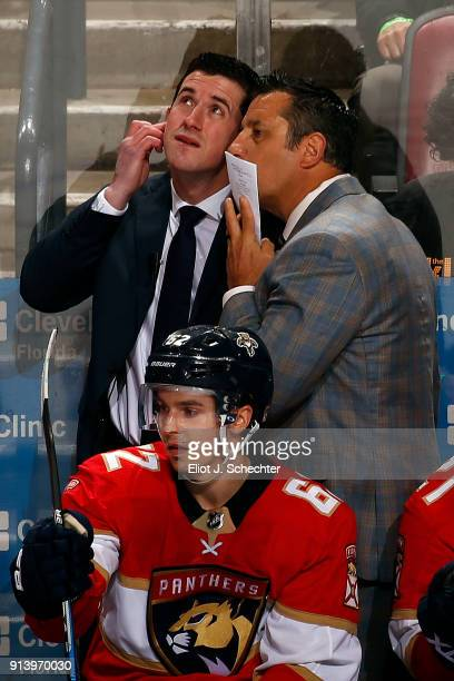 Florida Panthers Head Coach Bob Boughner whispers to Assistant Coach Paul McFarland during a break in the action against the Detroit Red Wings at the...