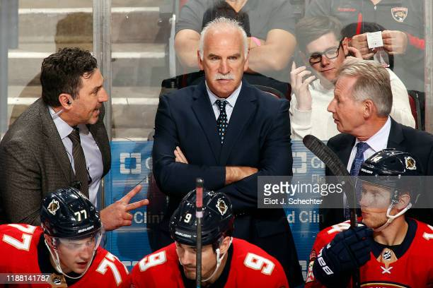 Florida Panthers Head Coach Joel Quenneville and Assistant Coaches Andrew Brunette and Mike Kitchen map out a plan in the third period against the...