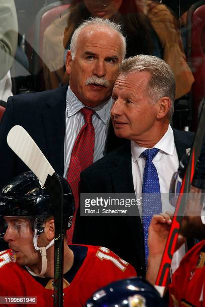 Florida Panthers Head Coach Joel Quenneville chats with Assistant Coach Mike Kitchen during a break in the action against the Pittsburgh Penguins at...