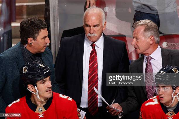 Florida Panthers Head Coach Joel Quenneville is flanked by Assistant Coch Andrew Brunette and Mike Kitchen during a break in the action against the...