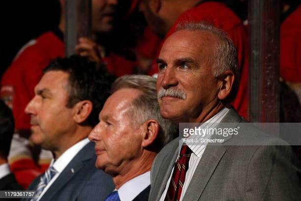 Florida Panthers Head Coach Joel Quenneville stands on the bench with Assistant Coaches Mike Kitchen and Andrew Brunette prior to the start of the...