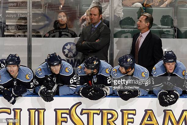 Florida Panthers Head Coach Peter DeBoer and Assistant Coach Mike Kitchen watch along with their team the play against the Atlanta Thrashers at the...