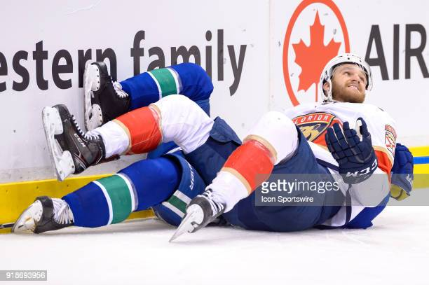 Florida Panthers Left Wing Jonathan Huberdeau ends up on top of Vancouver Canucks Defenceman Troy Stecher after a check during their NHL game at...