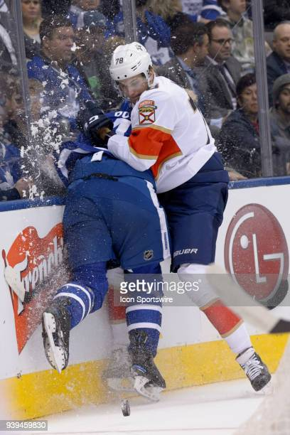 Florida Panthers Left Wing Maxim Mamin checks Toronto Maple Leafs Defenceman Roman Polak into the boards during the first period of the NHL regular...