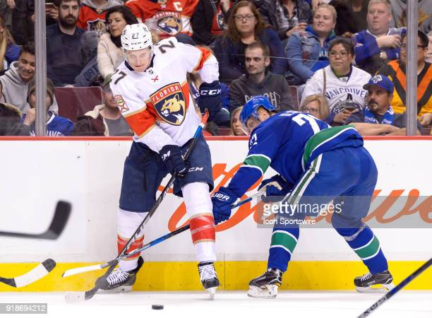 Florida Panthers Right Wing Nick Bjugstad passes the puck as he's checked by Vancouver Canucks Left Wing Daniel Sedin during their NHL game at Rogers...