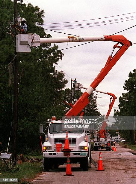 Florida Power and Light Company crews repair downed power lines 15 September 1999 in Titusville east central Florida after the passing of Hurricane...