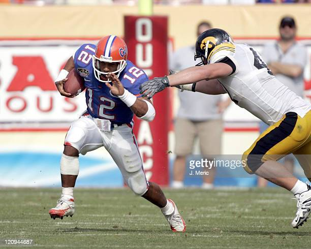 Florida quarterback Chris Leak looks for some additional yards as an Iowa defender attempts to bring him down in Monday's Outback Bowl at Raymond...