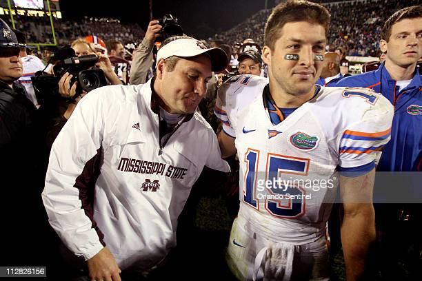 Florida quarterback Tim Tebow is congratulated by Mississippi State head coach Dan Mullen following the Gators 2919 victory over the Bulldogs in...