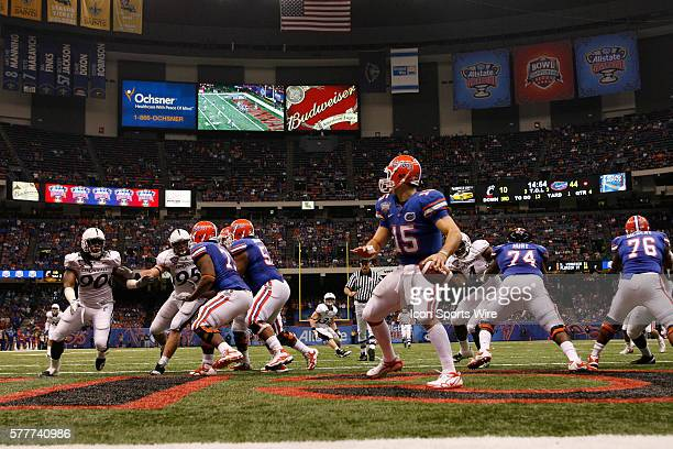 Florida quarterback Tim Tebow rolls out in the endzone looking for a receiver during the Gators 5124 victory over the Cincinnati Bearcats in the 2010...