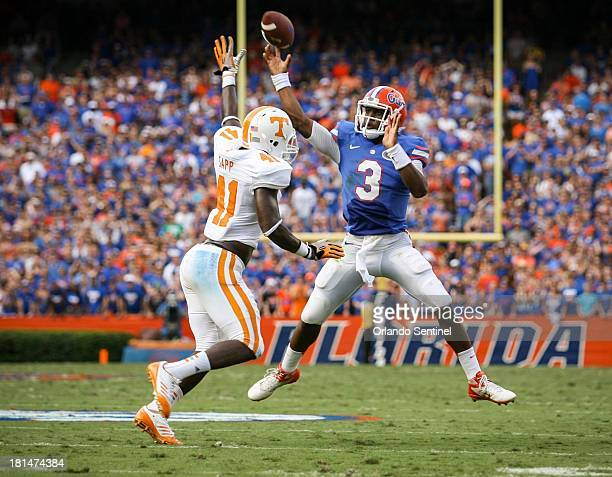 Florida quarterback Tyler Murphy gets off a pass as he is pressured by Tennessee's Dontavis Sapp during firstquarter action at Ben Hill Griffin...
