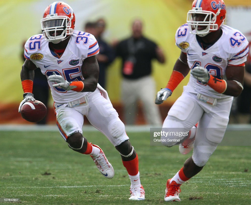 Florida safety Ahmad Black (35) runs back an interception during the first half against Penn State in the Outback Bowl in Tampa, Florida, Saturday, January 1, 2010. Florida defeated Penn State, 37-24.