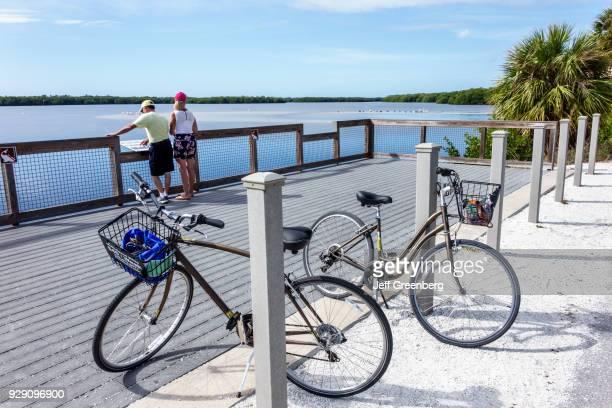 Florida, Sanibel Island, JN Ding Darling National Wildlife Refuge, Bicyclists take in View.