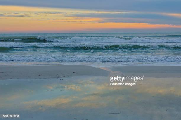 Florida, Sarasota, Crescent Beach, Siesta Key, Pastel Sunset over breaking waves.