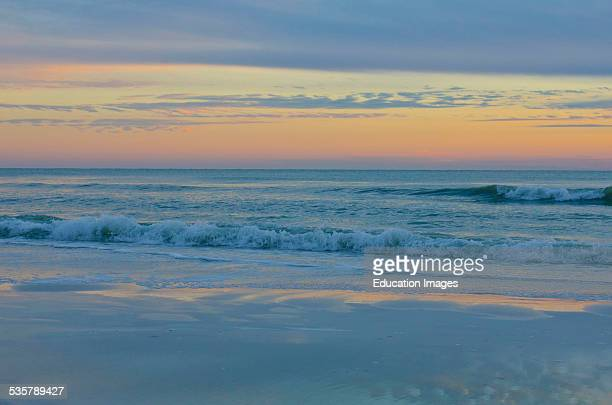 Florida, Sarasota, Crescent Beach, Siesta Key, Pastel Sunset over breaking waves.