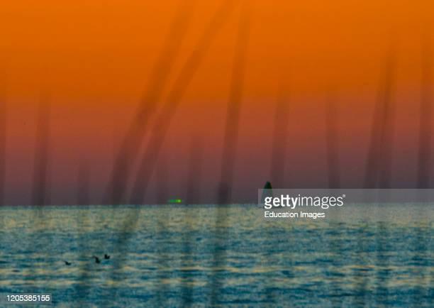 Florida, Sarasota, Siesta Key, Orange Sunset with rarely seen Green Flash.