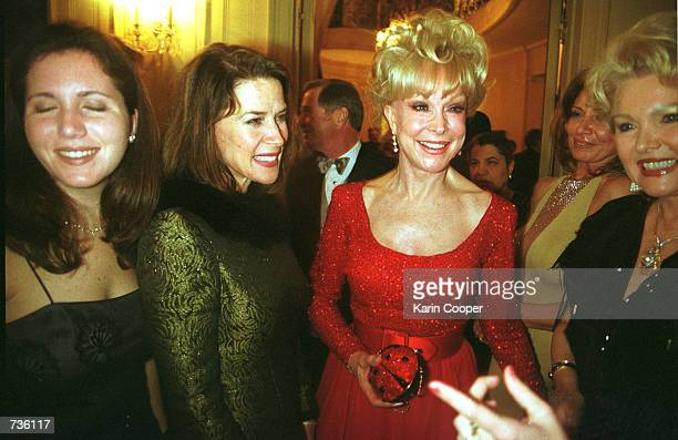 Florida Secretary of State Katherine Harris second left laughs with actress Barbara Eden during a party at the Ecuadorian Residence in Washington DC...