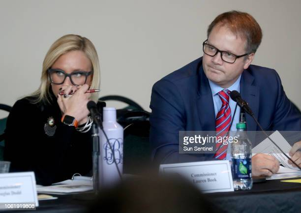 Florida Senator Lauren Book and Ryan Petty the father of shooting victim Alaina Petty listen to videos from the school shooting during the Marjory...