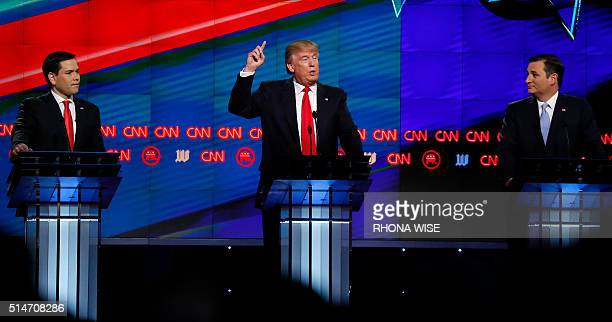 Florida Senator Marco Rubio and Texas Senator Ted Cruz watch Donald Trump speak during the CNN Republican Presidential Debate March 10 2016 in Miami...