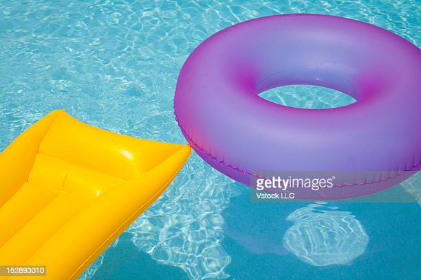 USA, Florida, St. Petersburg, Inner tube and pool raft floating on water