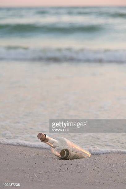 USA, Florida, St. Petersburg, Message in a bottle on beach