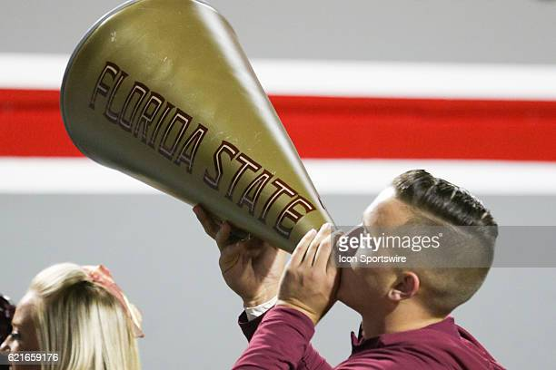 Florida State cheerleader leads the Seminole fans in a chant during the first half between the Florida State Seminoles and the NC State Wolfpack on...