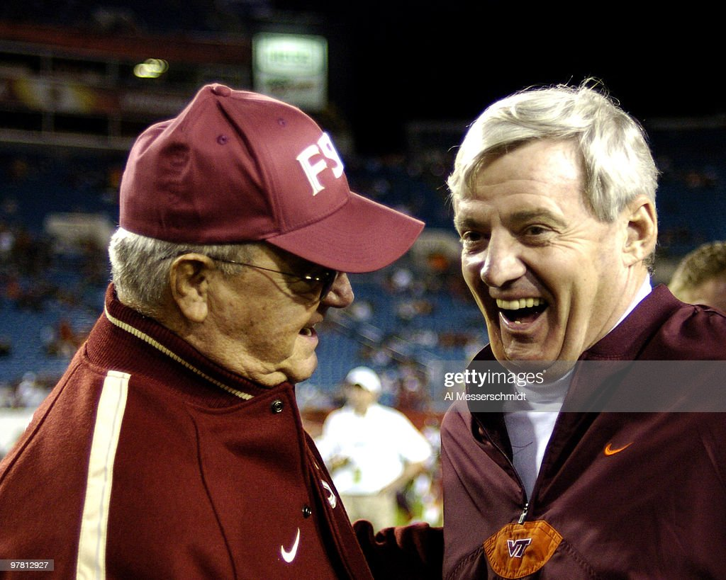 Florida State coach Bobby Bowden and Virginia Tech coach Frank Beamer talk at mid-field during pregame warmups before the 2005 ACC Championship Game in Jacksonville, Florida, Dec. 3, 2005.