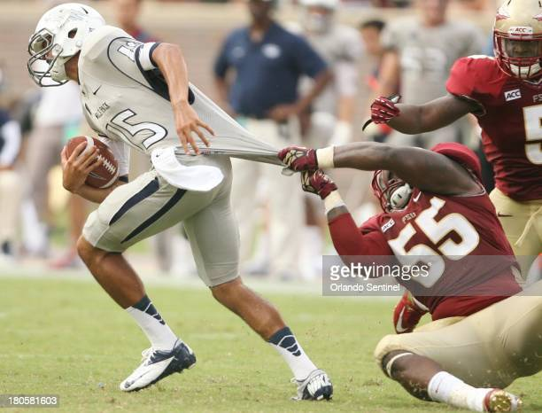Florida State defensive tackle Jacobbi McDaniel pulls down Nevada quarterback Tyler Stewart during game action at Doak Campbell Stadium in...