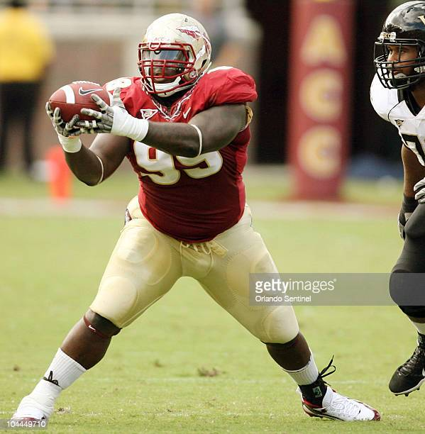 Florida State defensive tackle Jacobbi McDaniel pulls in an interception in front of Wake Forest offensive guard Joe Looney right at Doak Campbell...