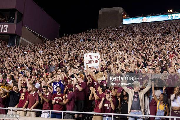 Florida State fan holds up a sign that says Now We're Cookin' during an NCAA football game between the Florida State Seminoles and the Clemson Tigers...