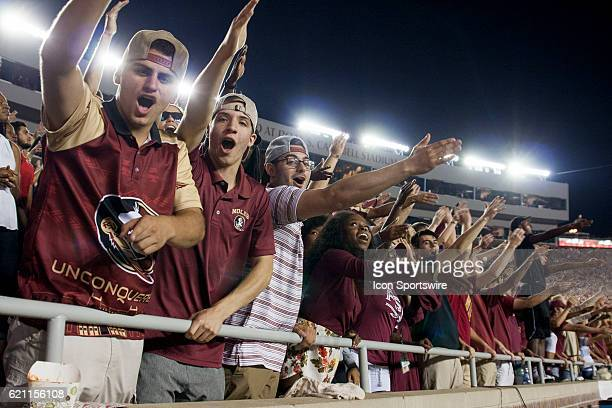 Florida State fans doing the tomahawk chop during an NCAA football game between the Florida State Seminoles and the Clemson Tigers on October 29 at...
