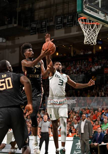 Florida State forward Jonathan Isaac shoots against Miami guard Anthony Lawrence Jr during a college basketball game between the Florida State...
