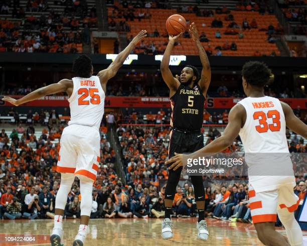 Florida State Guard PJ Savoy shoots a jump shot with Syracuse Orange Guard Tyus Battle defending and Syracuse Orange Forward Elijah Hughes during the...