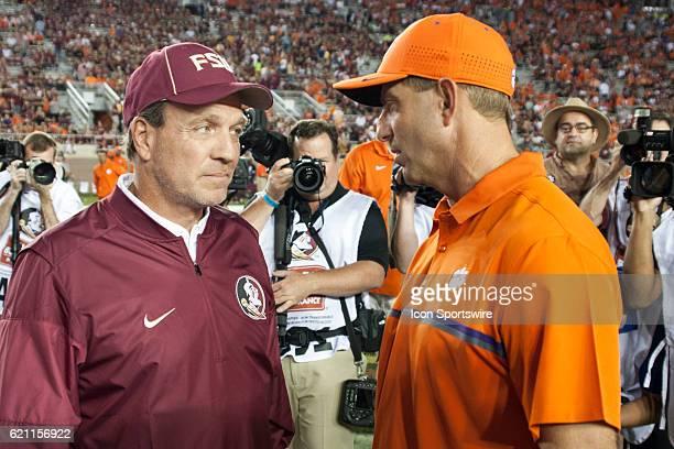 Florida State head coach Jimbo Fisher chatting with Clemson head coach Dabo Swinney before an NCAA football game between the Florida State Seminoles...