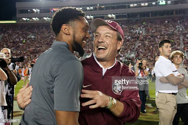 Florida State head coach Jimbo Fisher hugs former wide receiver Rashad Greene before an NCAA football game between the Florida State Seminoles and...
