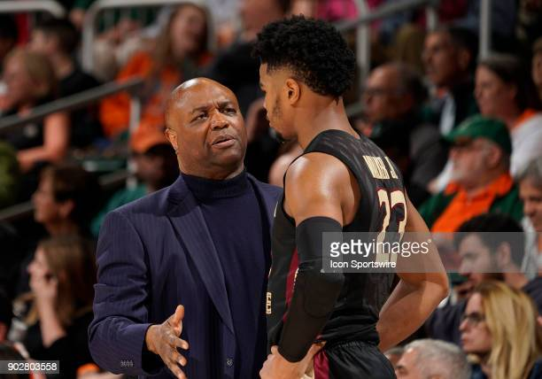 Florida State Head Coach Leonard Hamilton speaks to a player during a college basketball game between the Florida State University Seminoles and the...