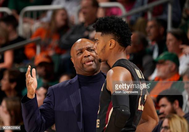 Florida State Head Coach Leonard Hamilton talks to a player during a college basketball game between the Florida State University Seminoles and the...