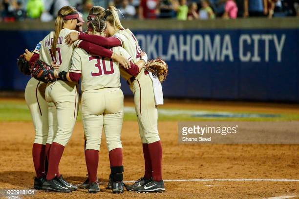 Florida State huddles during to game two of the Division I Women's Softball Championship held at USA Softball Hall of Fame Stadium OGE Energy Field...