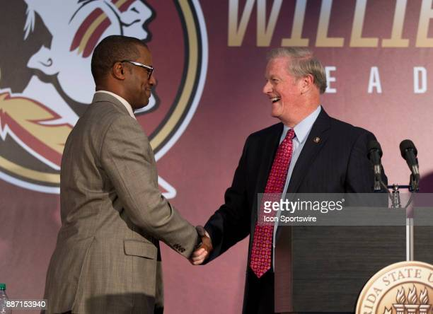 Florida State new head coach Willie Taggart shakes hands with president John Thrasher during the introductory press conference of Florida State's new...