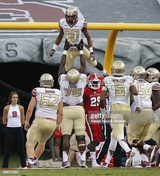 Florida State offensive tackle Cameron Erving lifts up Florida State wide receiver Rashad Greene after he scored on 4yard touchdown reception during...
