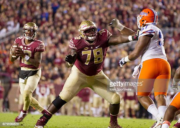 Florida State OL Wilson Bell blocking for Florida State QB Deondre Francois during the NCAA football game between the Florida State Seminoles and the...