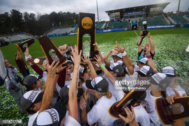 Florida State players celebrate with the national championship trophy after winning the Division I Women's Soccer Championship held at WakeMed Soccer...