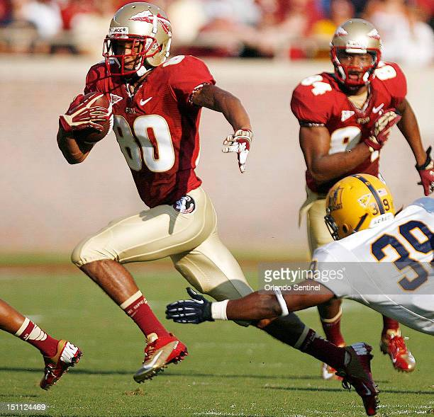 Florida State punt returner Rashad Greene evades Murray State linebacker Blake Salter as Greene runs a punt back for a touchdown at Doak Campbell...